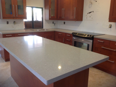 Silestone Shitake Kitchen Counter top with Brown Base cabinets