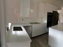 White Quartz Counter Tops with White Cabinets and frosted glass cabinet doors