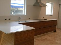 White Quartz Counter with Light Brown Cabinets