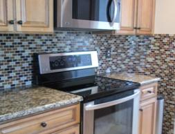 granite countertops with glass tile