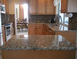 granite countertops and glass tile